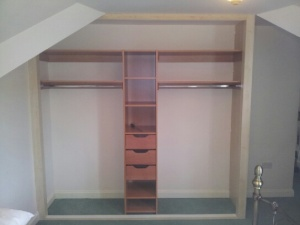 keep the bedroom organised with sliding wardrobe doors