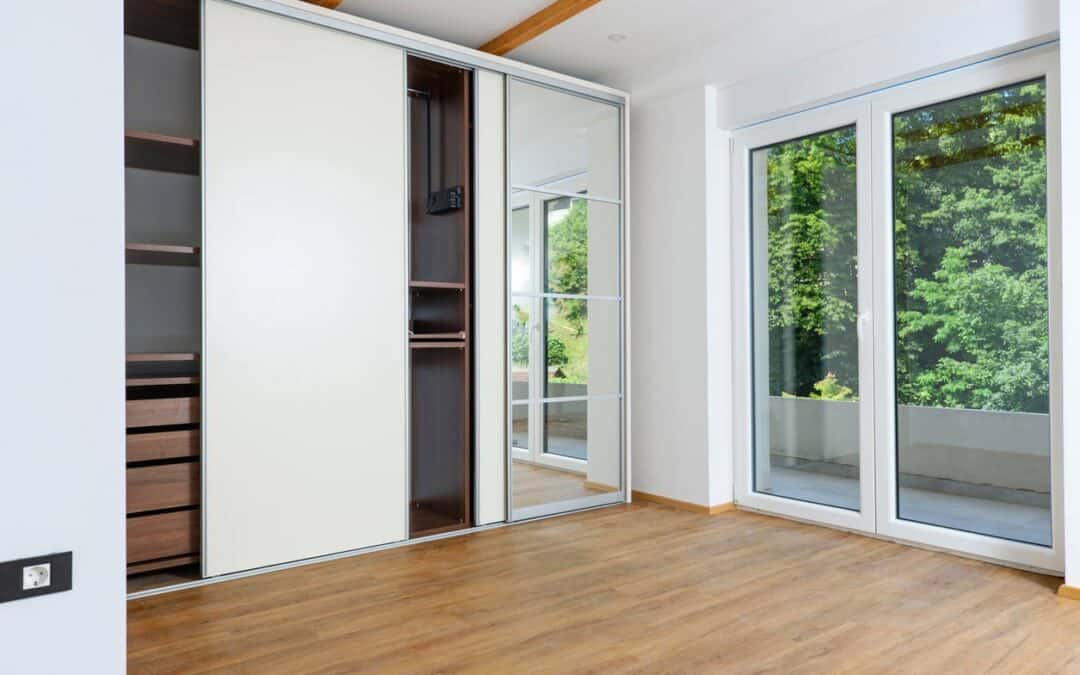 What materials are used for sliding wardrobe doors?