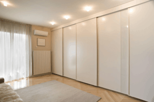 Room with split type aircon and sliding closet doors